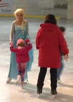 Elsa-guides-skater.jpg